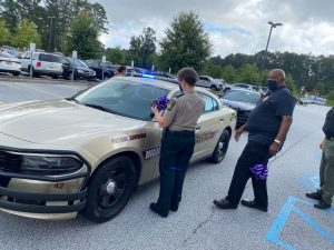 S.H.A.R.E. House Purple Ribbons on Police Vehicle for Domestic Violence Awareness Month